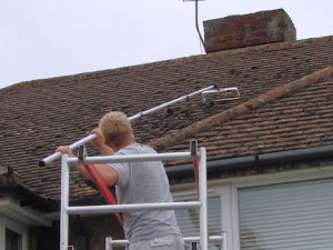 ... Manually Scraping Moss Off A Roof Prior To Soft Washing   All Roof  Cleaning Services By
